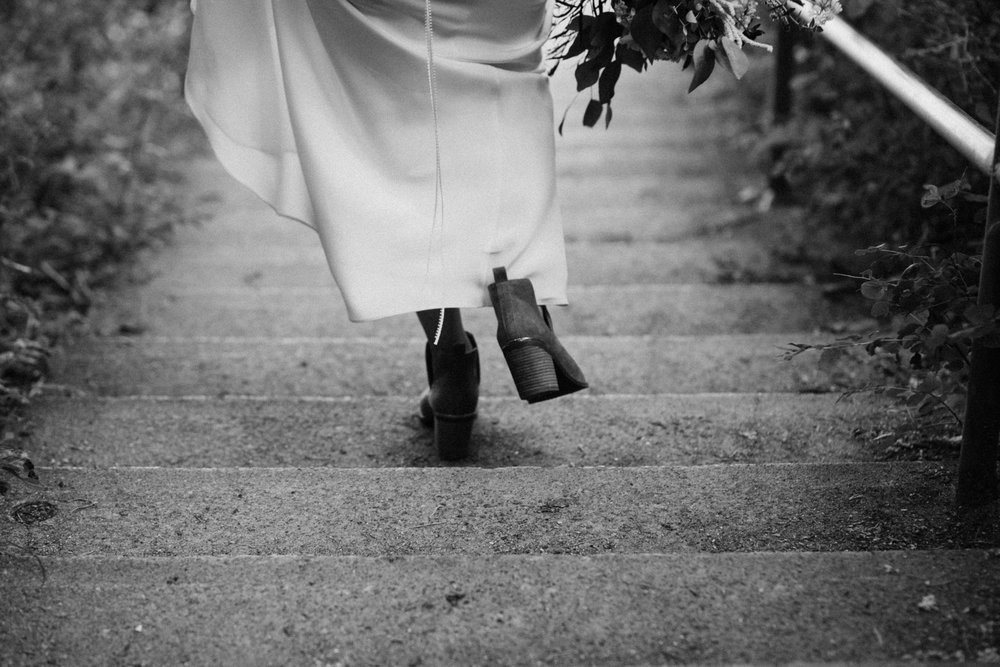 bride walks down stairs to Mount Doug beach, Victoria elopement photographer