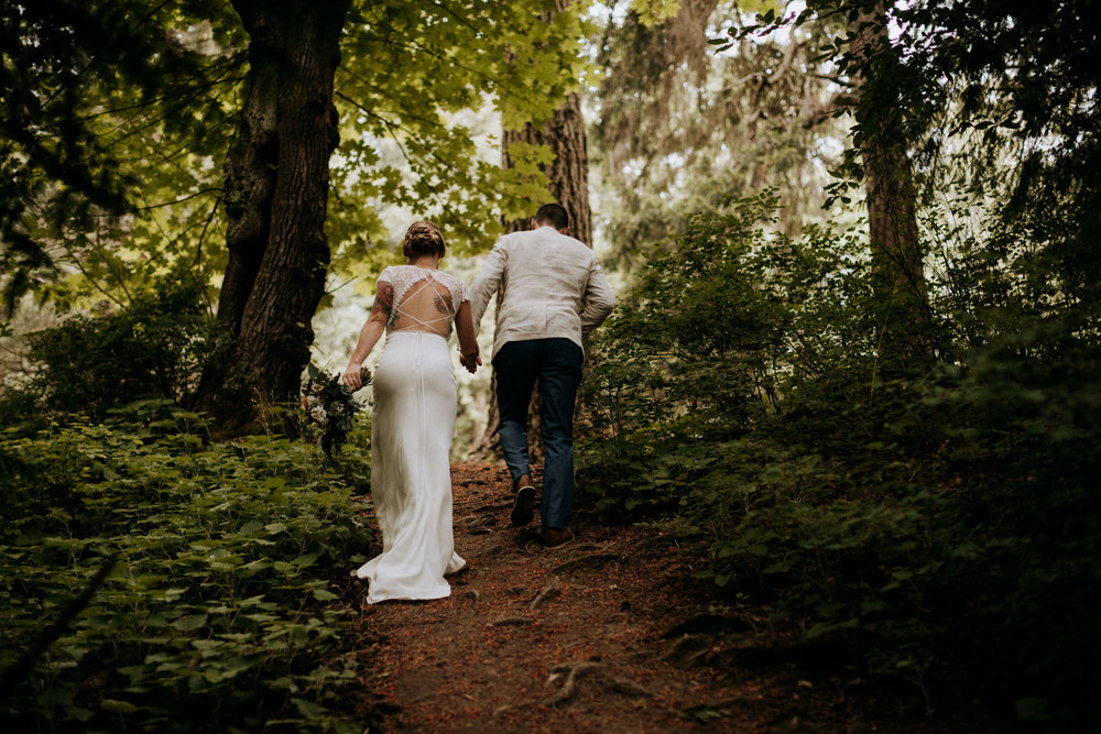 bride and groom leave forest at Mount Douglas Vancouver Island Elopement Photographer