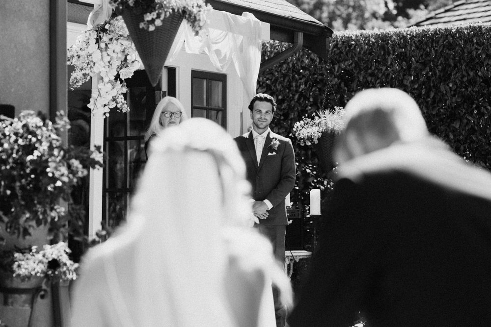 groom sees bride at West Vancouver backyard wedding photographer
