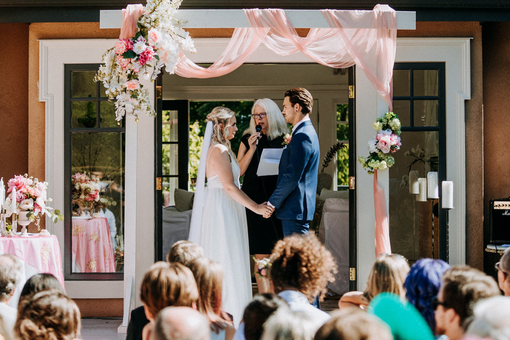 bride and groom exchange vows West Vancouver backyard wedding photographer