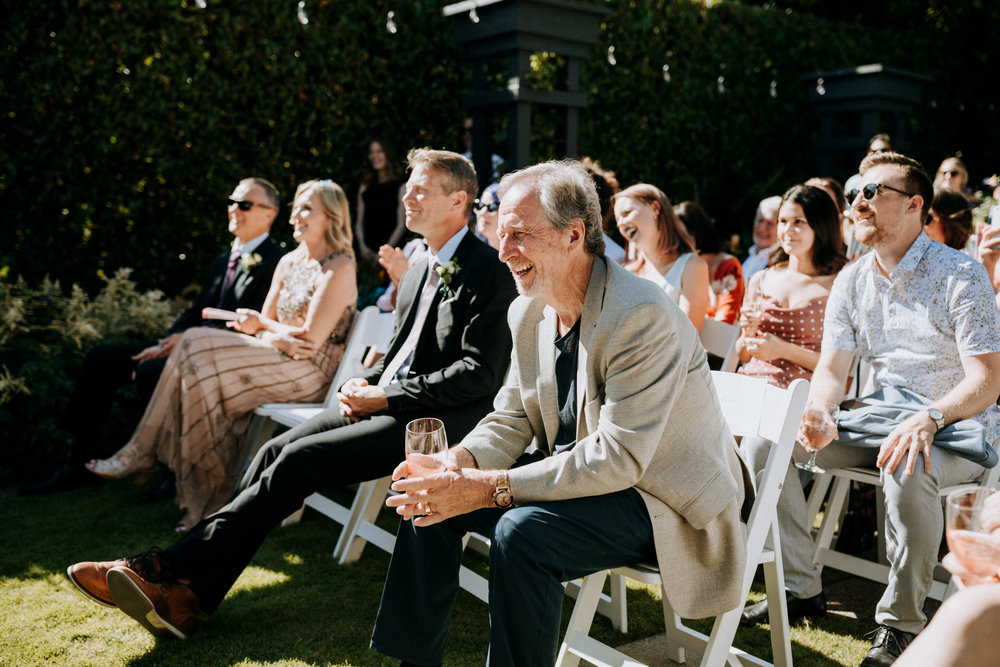 guest smiles at ceremony West Vancouver backyard wedding photographer