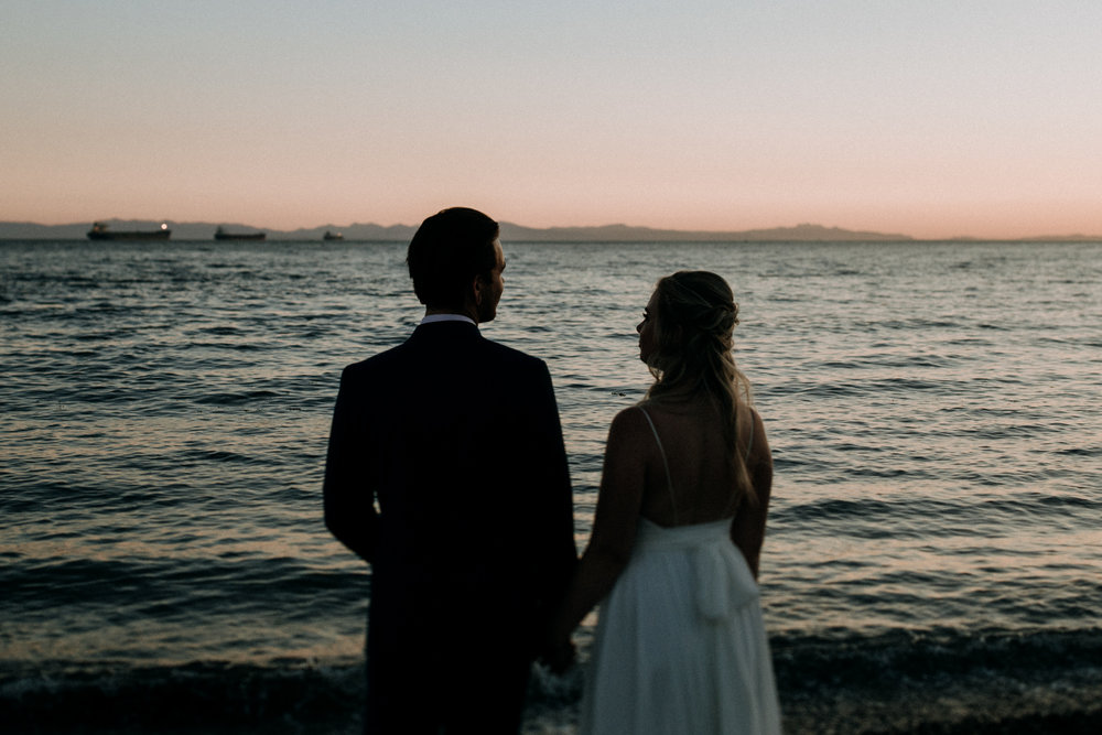 bride and groom in sunset at Ambleside Park West Vancouver