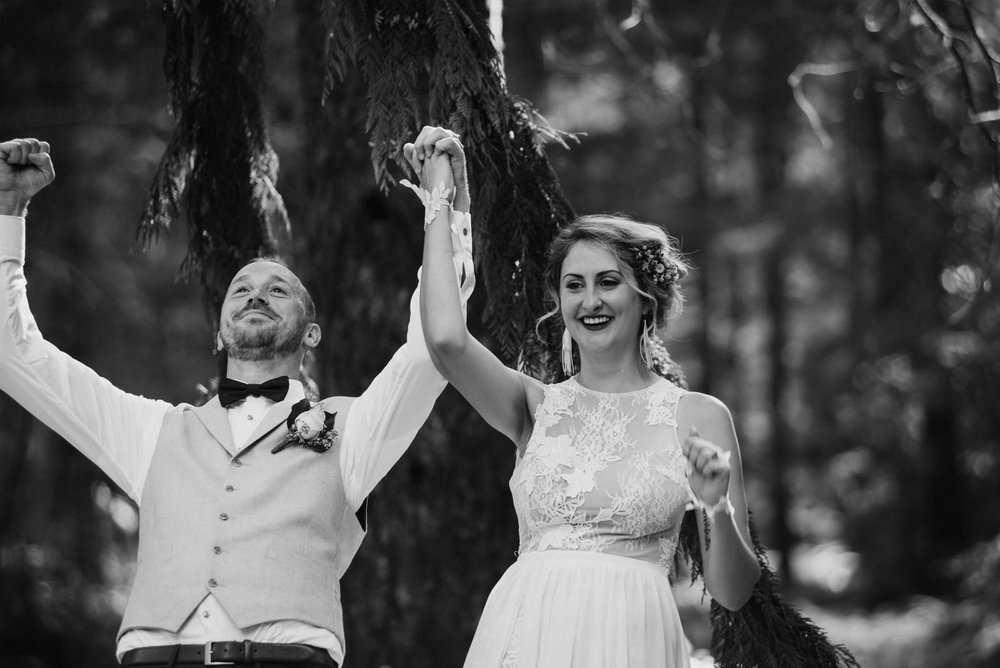 bride and groom celebrate being married Port Alberni wedding Photographer
