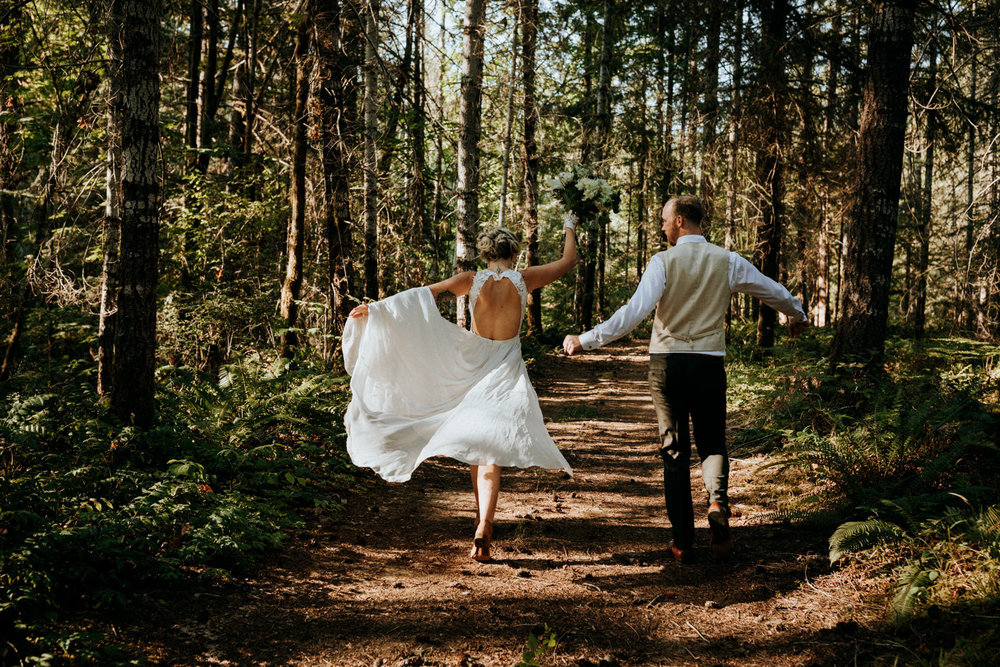 bride and groom dance in forest Port Alberni wedding Photographer