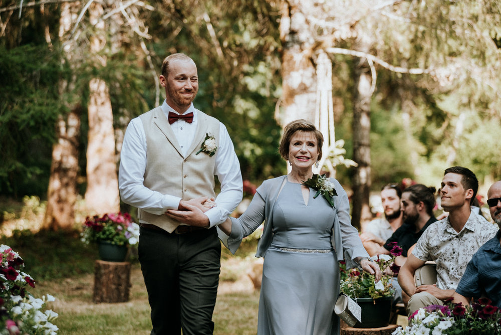 groom and mother walk down isle Port Alberni wedding Photographer