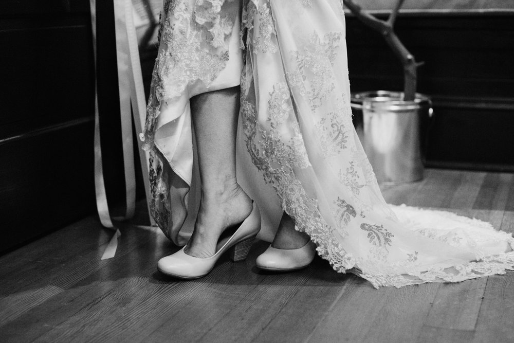 bride putting shoes one, intimate Victoria wedding photographer