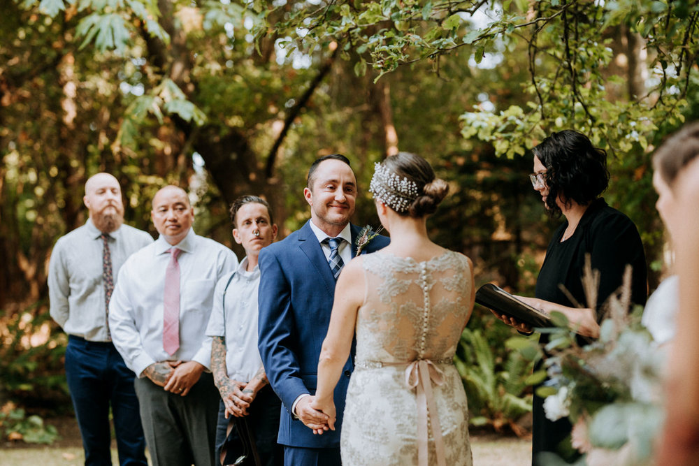 groom smiles at bride intimate Victoria wedding photographer