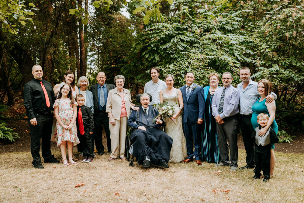 Family photo after wedding ceremony, intimate Victoria wedding photographer