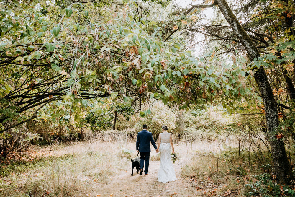 bride and groom walk through forest, intimate Victoria wedding