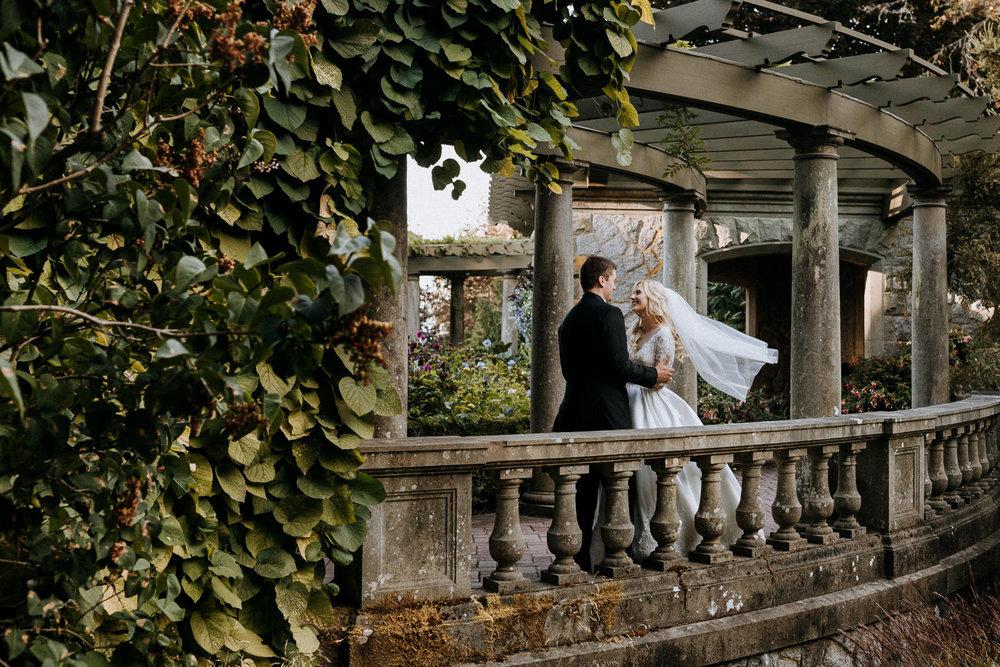 newly weds pose in Italian garden Hatley Castle Wedding Photographer