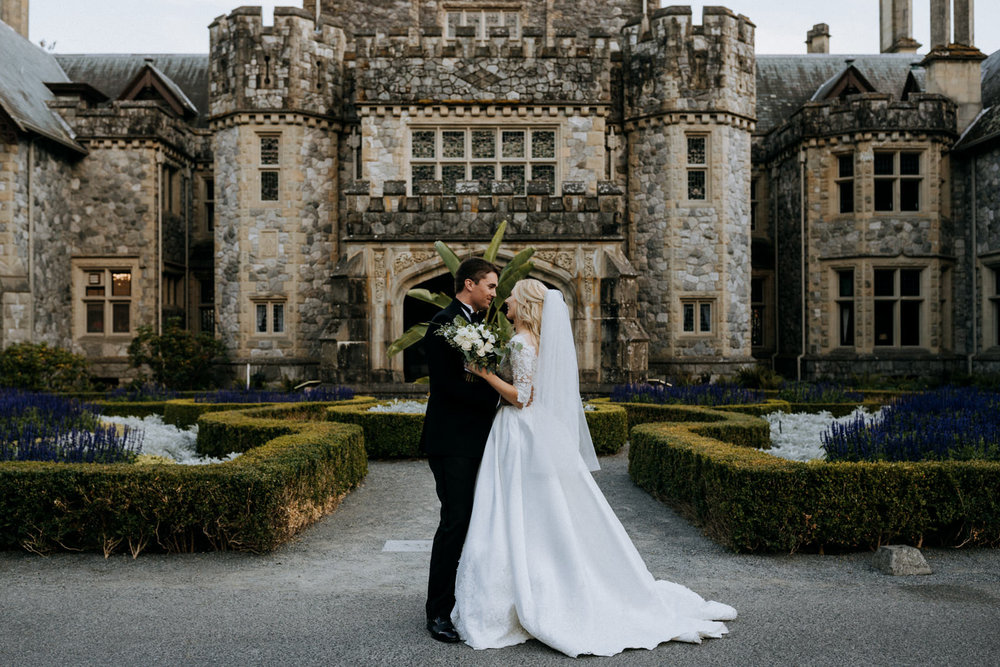 newly weds outside Hatley Castle Wedding Photographer