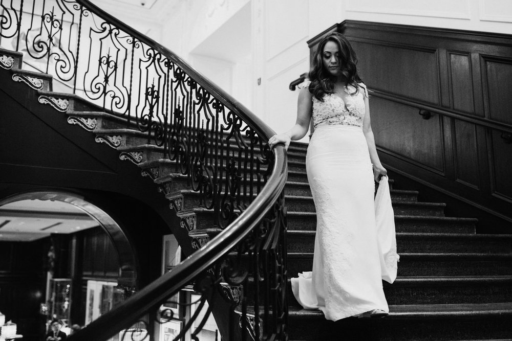 bride walks down stairs Hotel Georgia Vancouver Wedding Photographer
