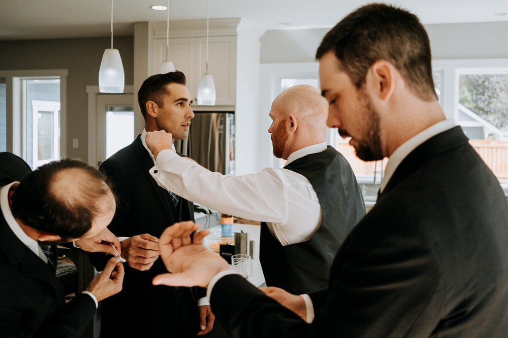 Groom gets ready with groomsmen Courtenay Comox wedding photographer