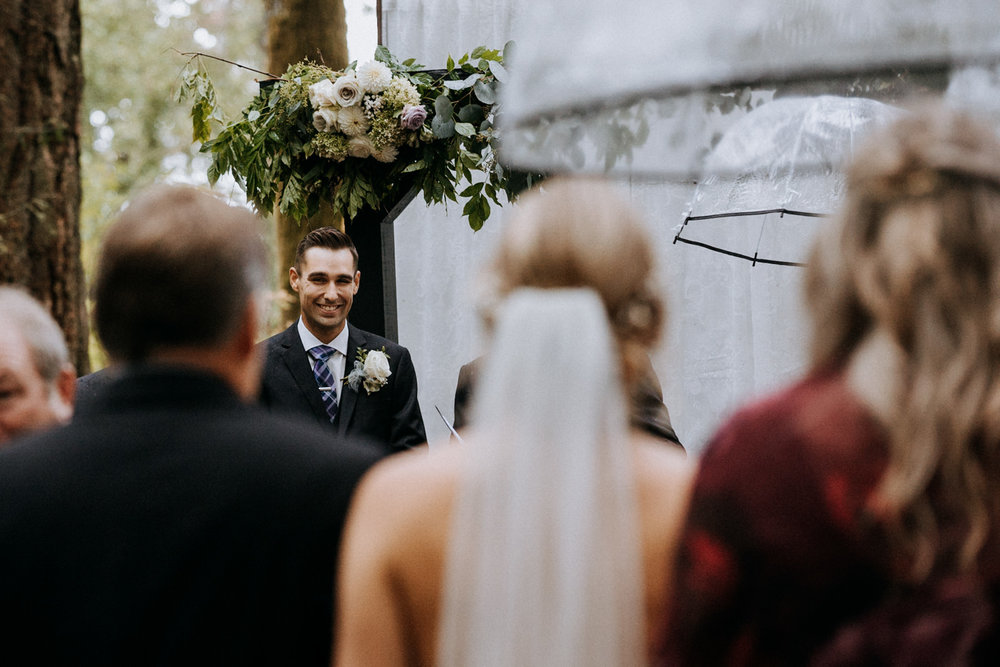 groom sees bride at Miracle Beach ceremony Courtenay Comox wedding photographer