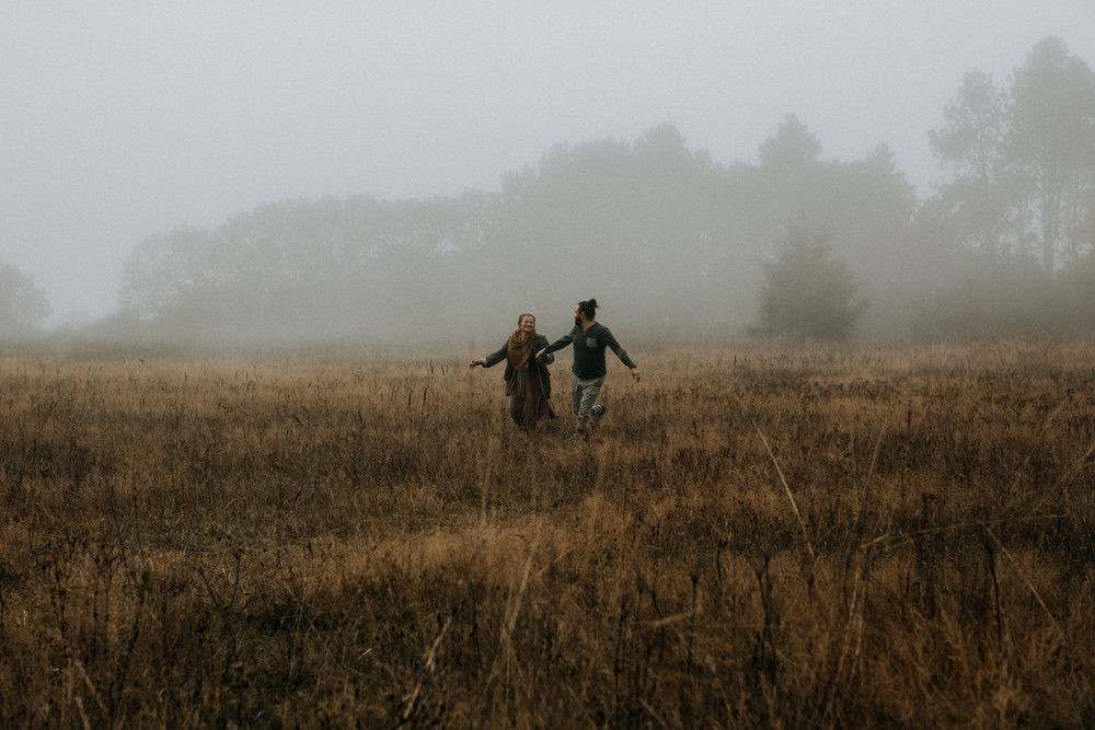 couple runs through fog Beacon Hill - Vancouver Island Elopement Photographer