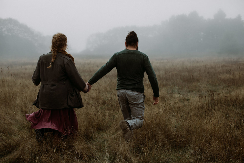 couple walks through fog at Beacon Hill - Vancouver Island Elopement Photographer