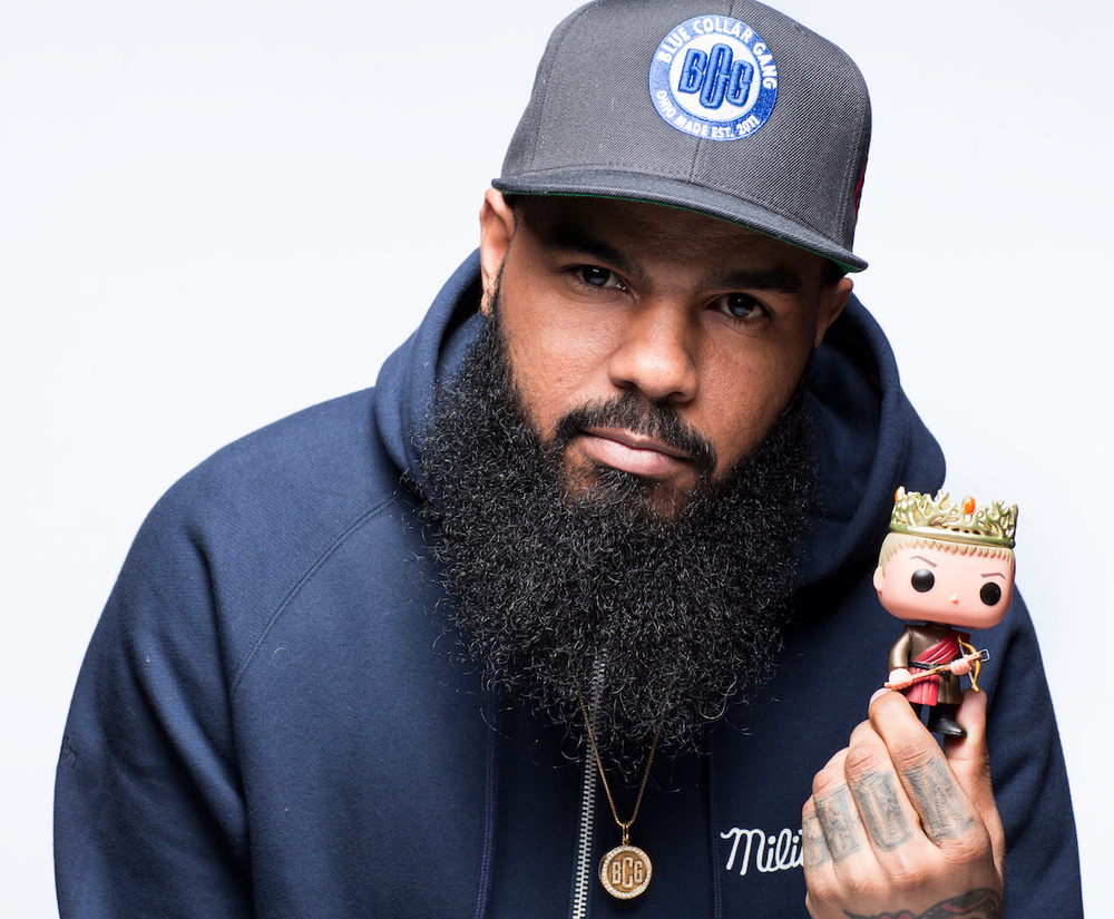 Stalley poses with a Joffrey Funko doll.
