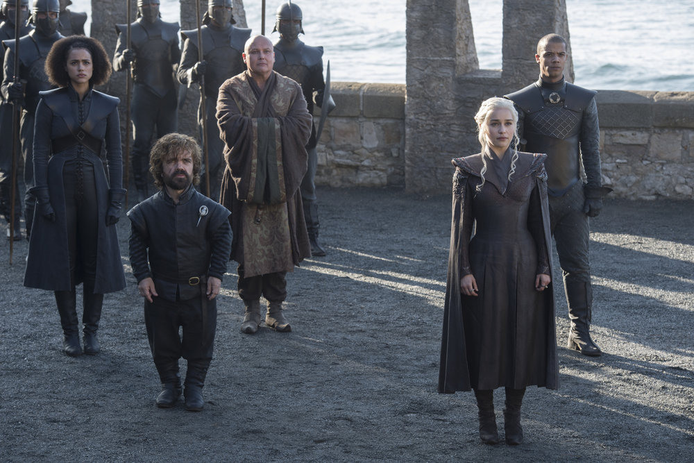 (Left to Right)  Nathalie Emmanuel  as Missandei,  Peter Dinklage  as Tyrion Lannister,  Conleth Hill  as Varys,  Emilia Clarke  as Daenerys Targaryen, and  Jacob Anderson  as Grey Worm -  Photo: Macall B. Polay/HBO