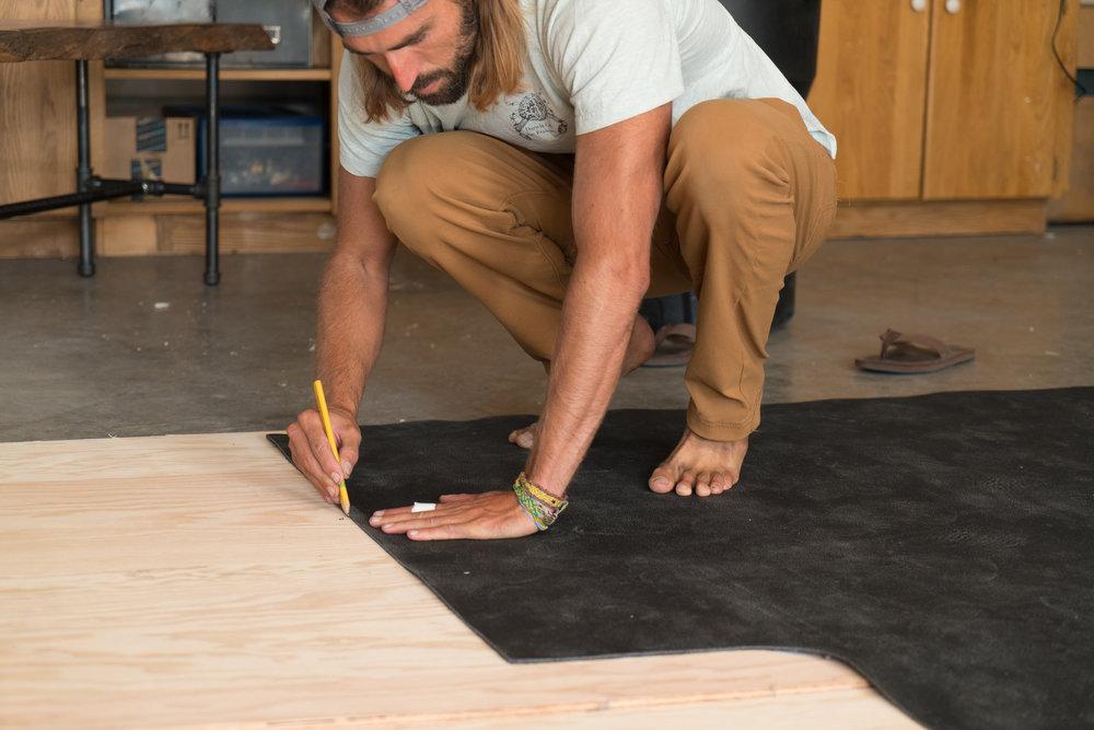 Tracing the original floor mat to create a flush subfloor