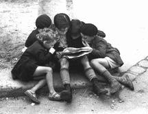 Children Reading Newspaper