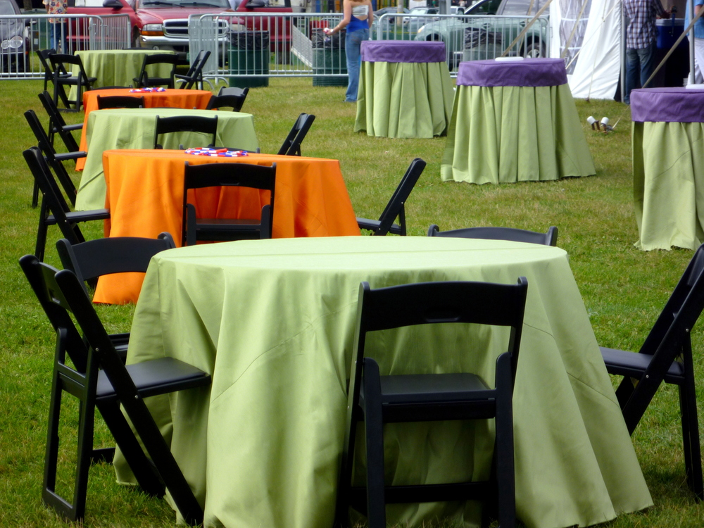 cocktail tables, black chairs, orange & green Roma linen.JPG
