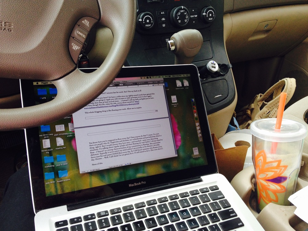The twins are at art class and they don't allow me to leave the parking lot. So this is where I do my work. At least I have my green tea—that never fails to make everything okay.