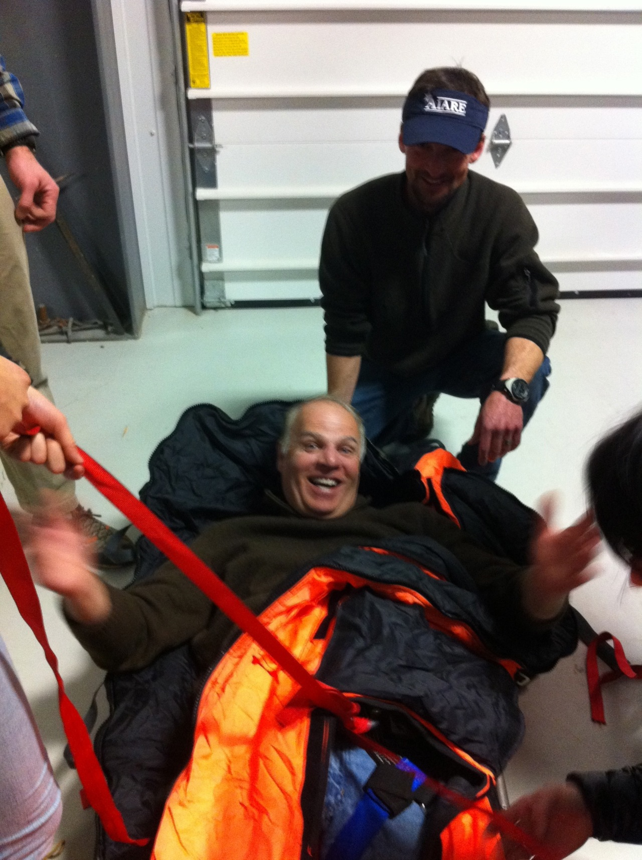 TCSAR members are training on Winter packaging and patient transport his month.  In this picture the president of TCSAR Tim Ciocarlan tries to escape from the clutches of the team!  Thanks for all you do Tim.