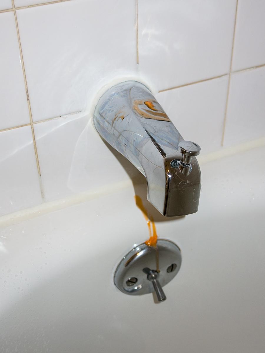 orange-drip-on-tub-tap
