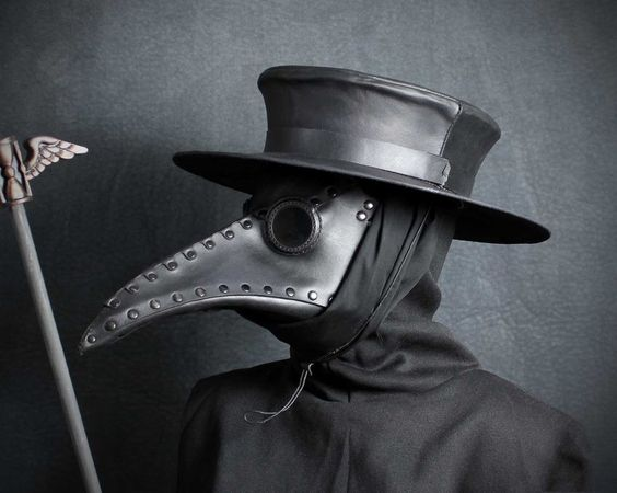 "Reproduction of the uniform of a 17th-century plague doctor. The ""beak"" contained things like lemon balm, cloves, myrrh, rose petals and even laudanum, to protect the doctor from the ""miasma"" (bad air) that supposedly caused plague."