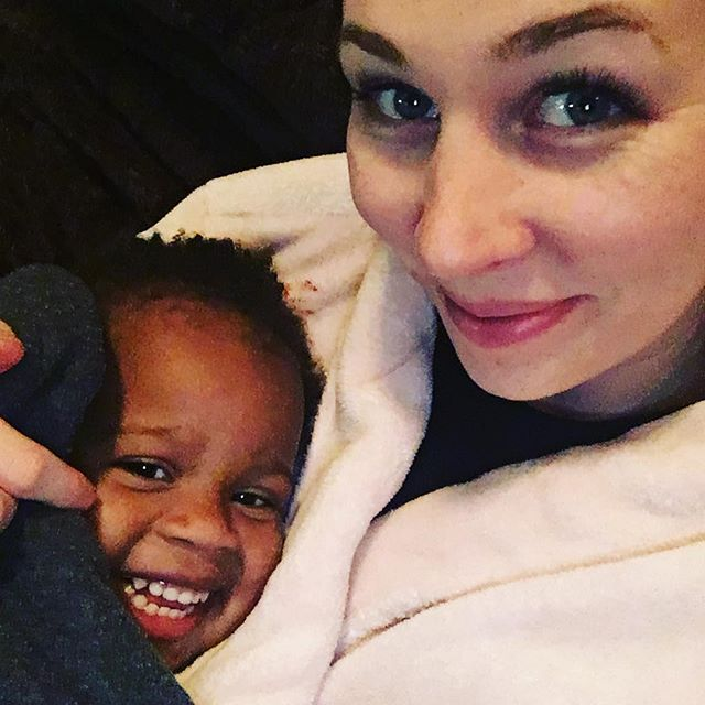 """This is her, """"My Mommy is a sucker because I'm supposed to be asleep but I am being snuggled while she watches a movie with Daddy"""" smile.  #kidnumberfive #daddylookslikethis 🙄"""