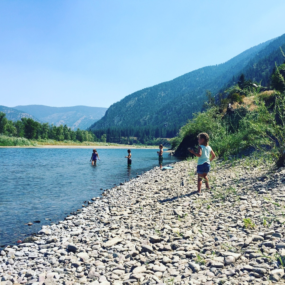 The kids skipping stones and looking for Cotton on the Clark Fork River just beneath the railroad tracks.