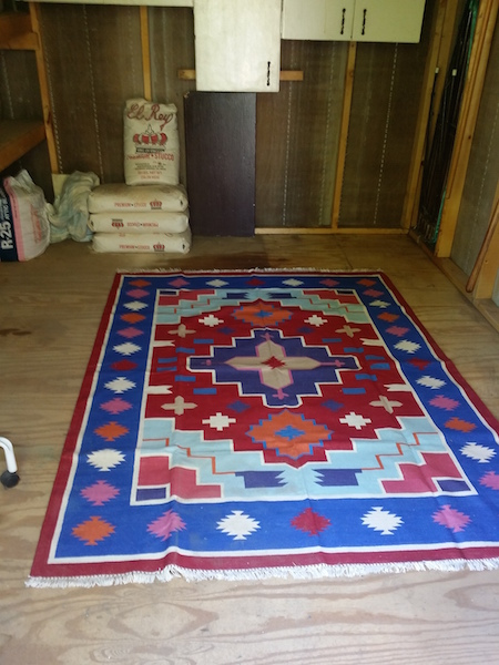 After emptying most of the shed, all that is left is Chuck's El Rey stucco (maybe pink). A rug to make things homier.