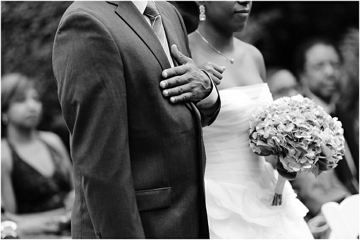 a - Free Library of Philadelphia Wedding - processional hand on heart.jpg