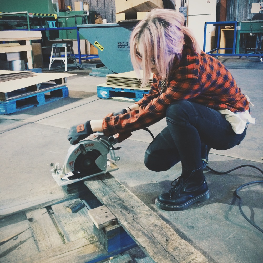 Chopping up old palettes with a Skilsaw.