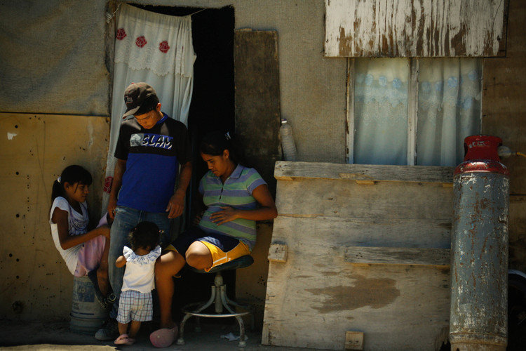 Family Sitting Outside Pallet House