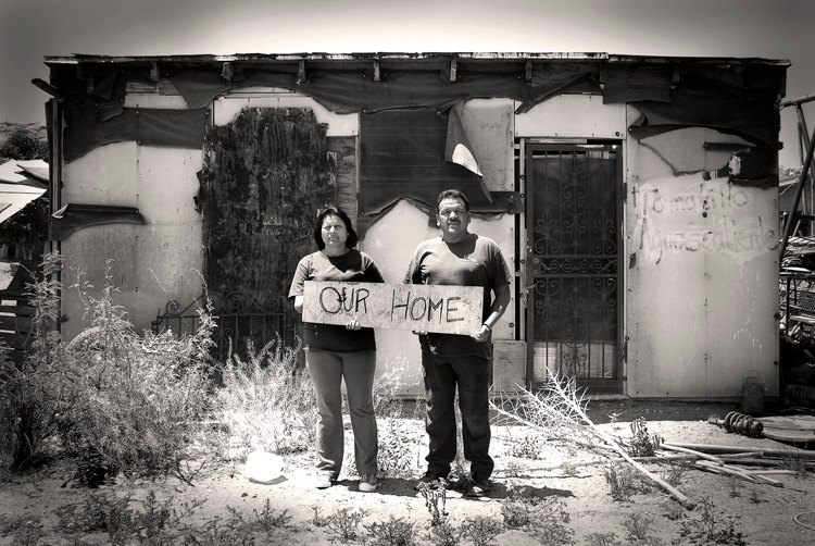 Juarez Mexico Family Holding Sign