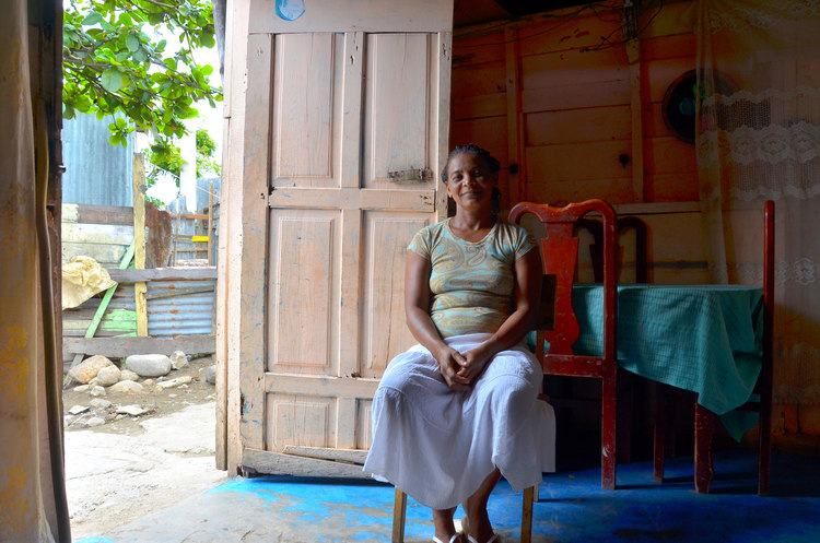 Dominican Woman Sitting in a Chair