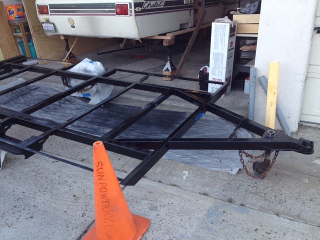 New paint on Chalet trailer frame.