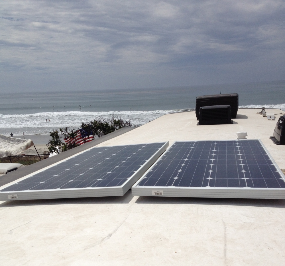 Two 160 watt panels installed on a Class A motorhome at San Elijo State Beach.