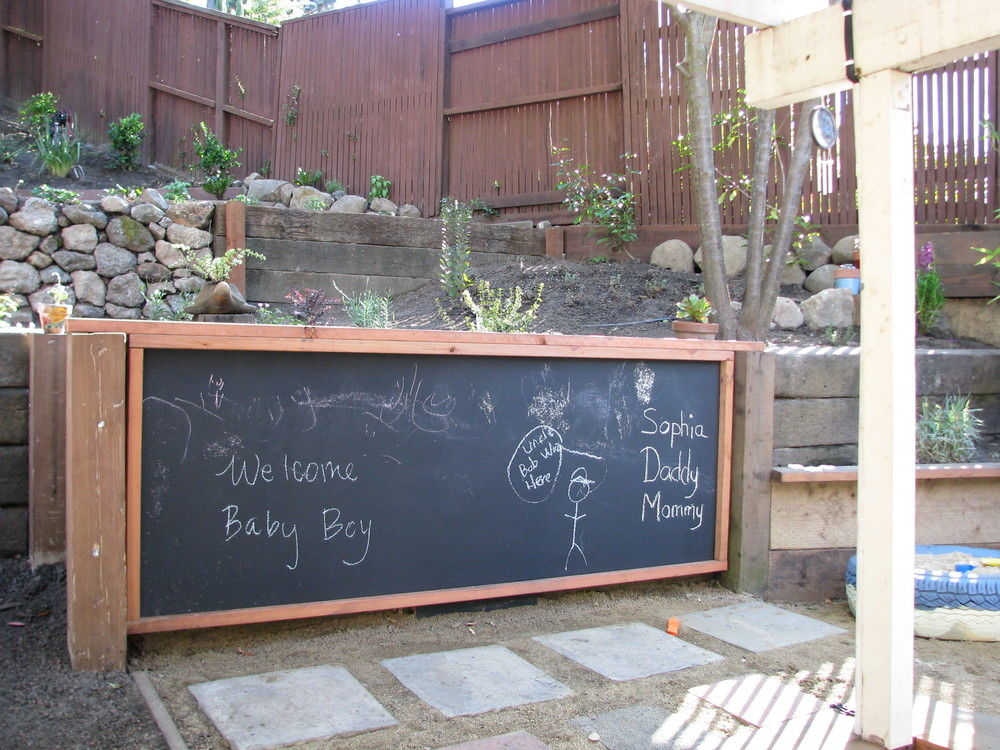 A chalk board for drawing and a tire sand box for building!