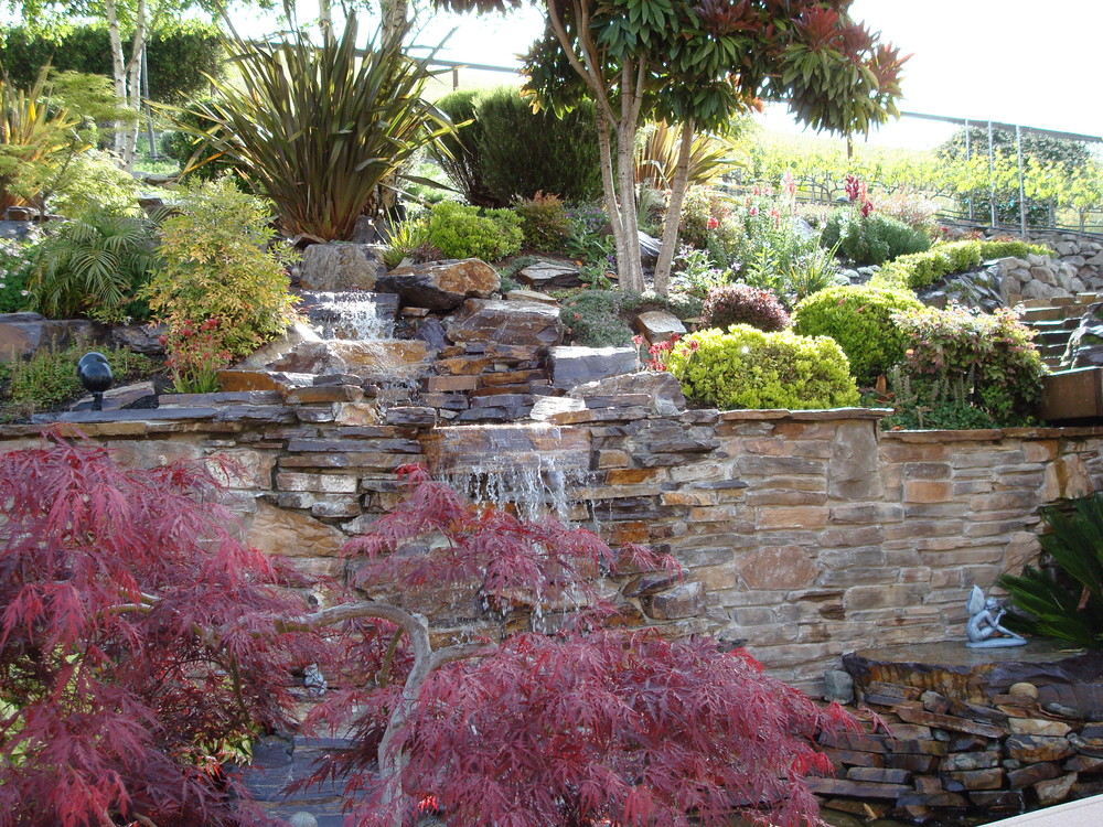 This water feature adds sound to the garden experience while keeping the space cool.