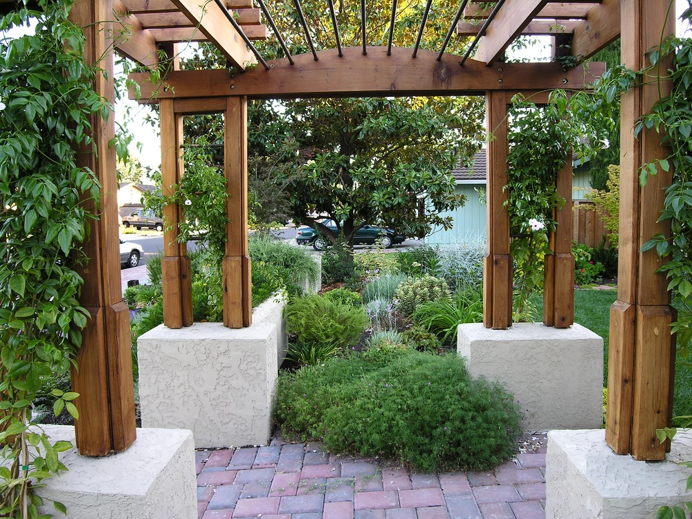 An arbor helps create a sense of entry and transition.