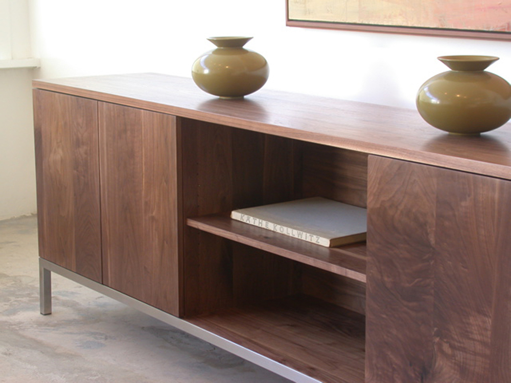 shown in solid walnut