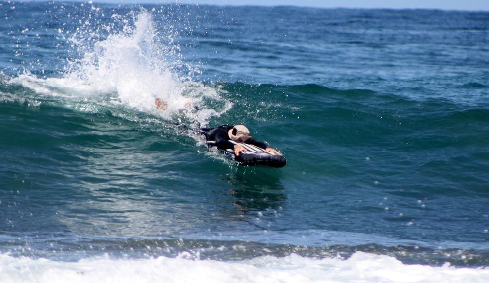Warren Pfeiffer kicking into a wave. Photo: Eliza Pfeiffer