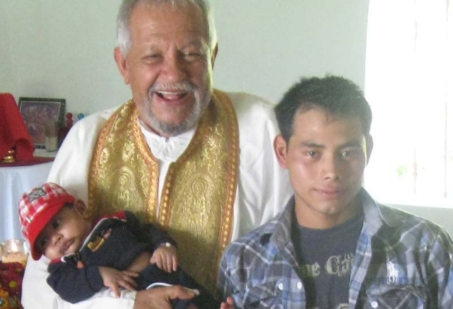 The late Fr. Andrés Girón, blessing a child in Nueva Concepción