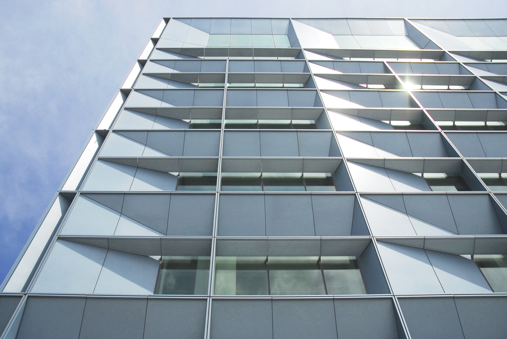 Aluminum-and-glass curtain walldetail with daylight-harvesting light shelves,Recruit Academic Building - 2015