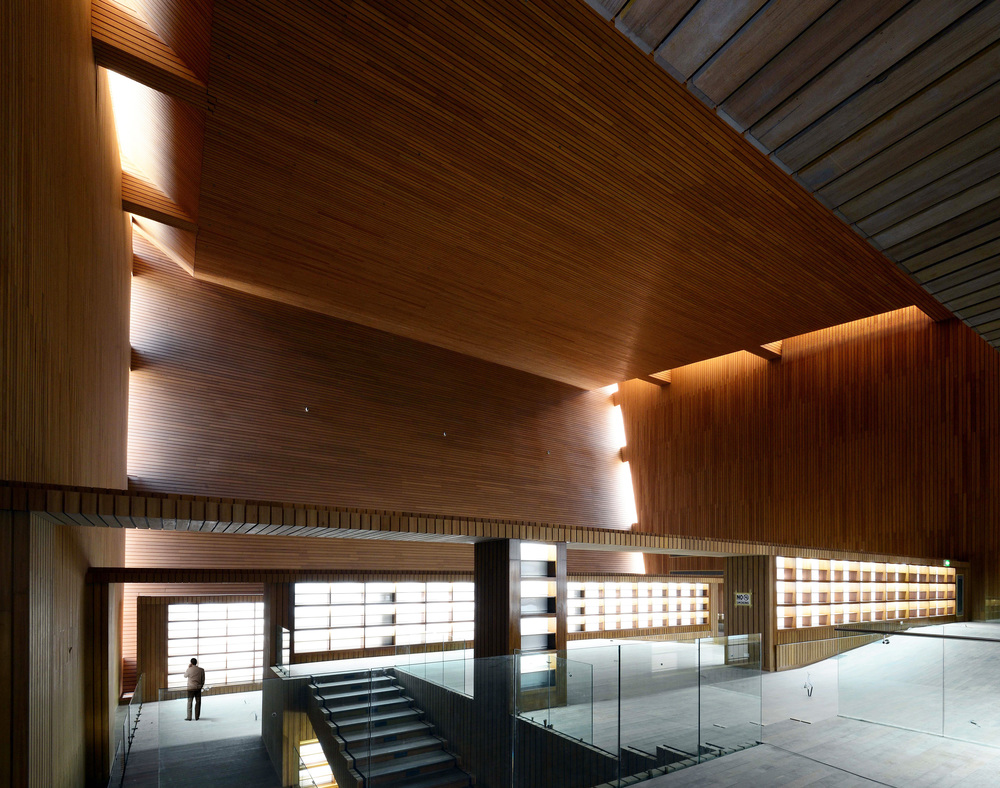 Photograph of near-complete, wood-clad Library Interior