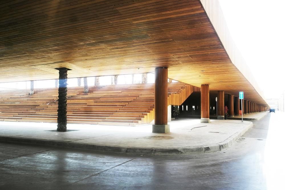 MonumentalStair to elevated, wood-clad ceremonial deck (shadedparking below)