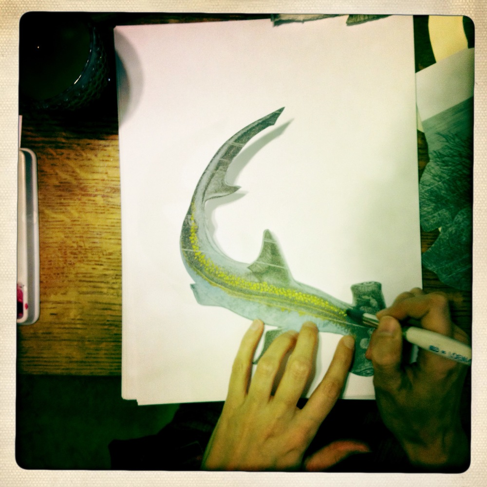 Here is a shot of Dani painting a Hammerhead shark.