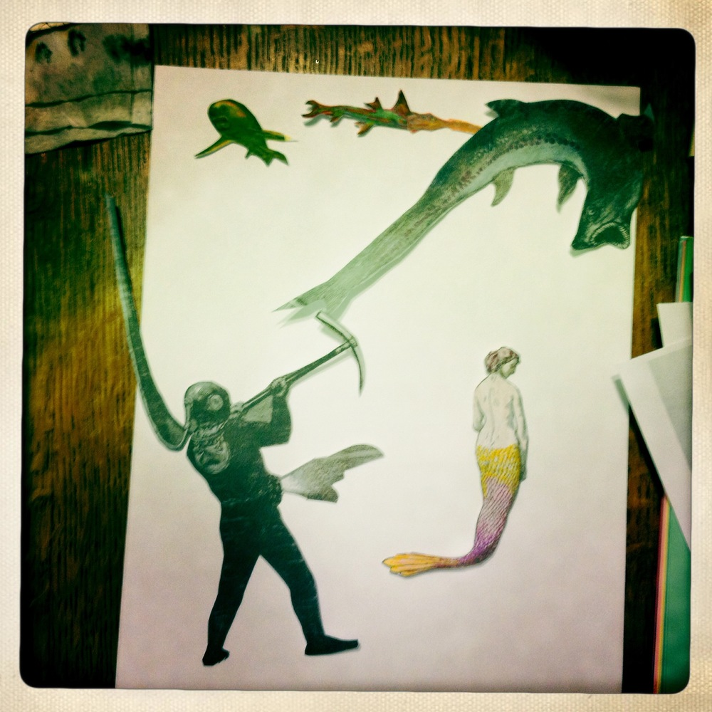 In this shot there are some sharks, a deep-sea diver and a mermaid at various stages of completion.